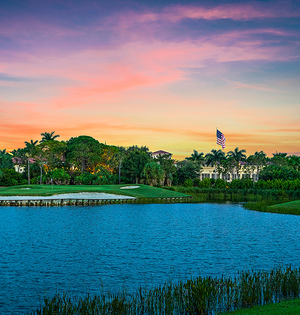 Timbers Jupiter golf community and golf clubhouse at sunset.