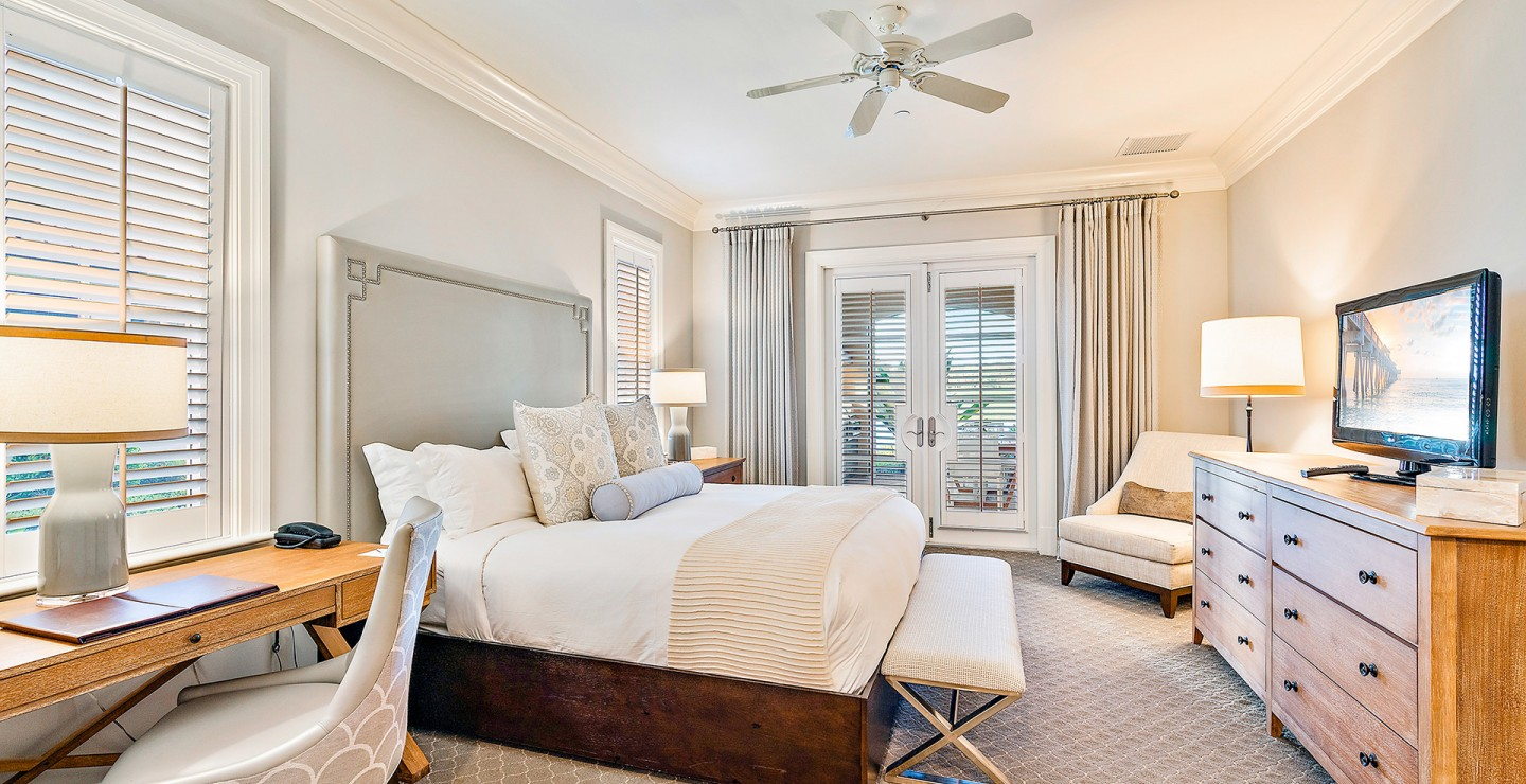 Furnished bedroom at one of the luxury Florida villas for sale at Timbers Jupiter