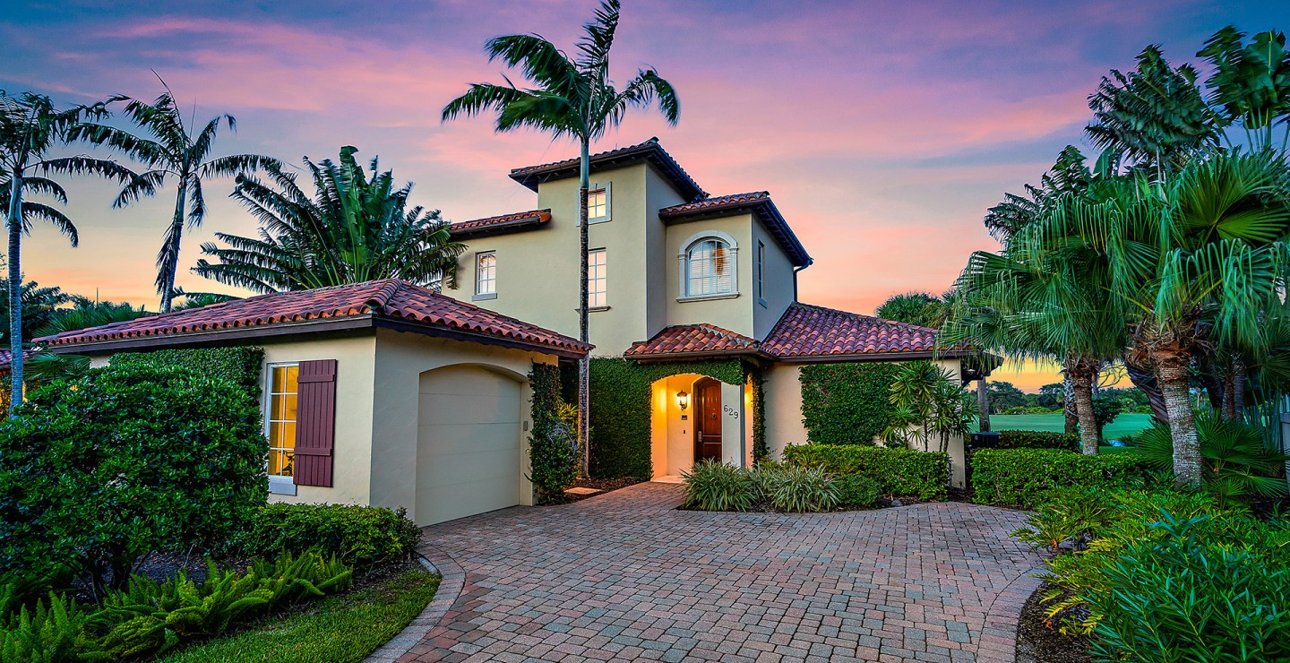 Exterior of a four-bedroom home for sale on a golf community in Jupiter, Florida